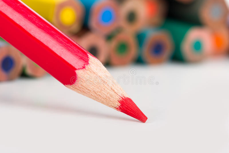 Red Pencil. Writing on white stock image