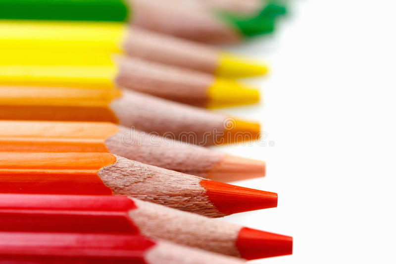 Red Pencils macro on white, school supplies royalty free stock image