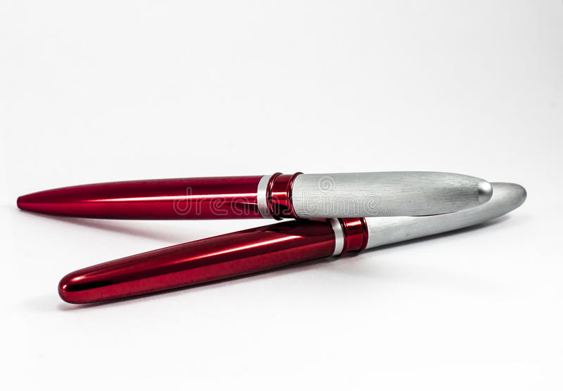 RED PENS. ON A WHITE BACKGROUND royalty free stock photo