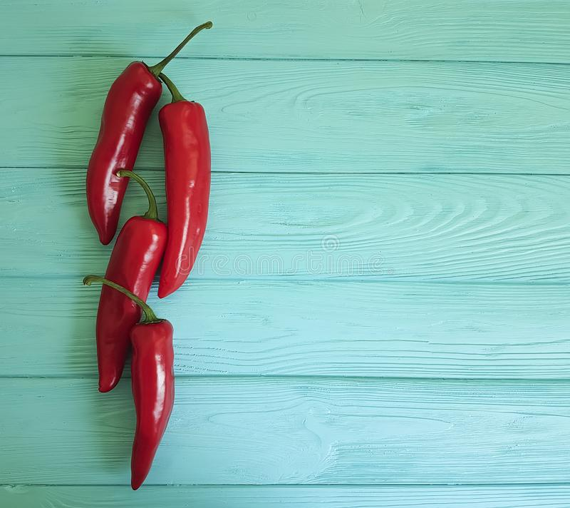Red pepper on a blue wooden background cayenne spice. Red pepper a blue wooden background spice cayenne stock photos