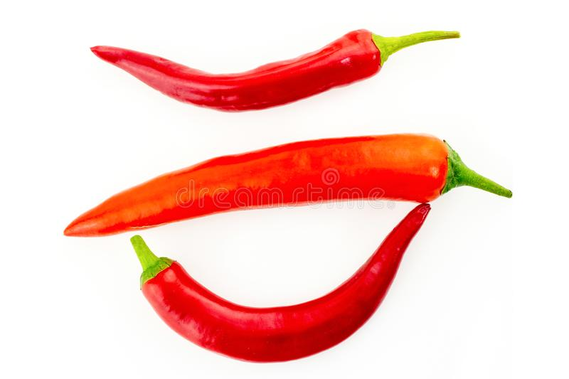 Red pepper bright spicy tasty three vegetable pods white isolated background stock photos
