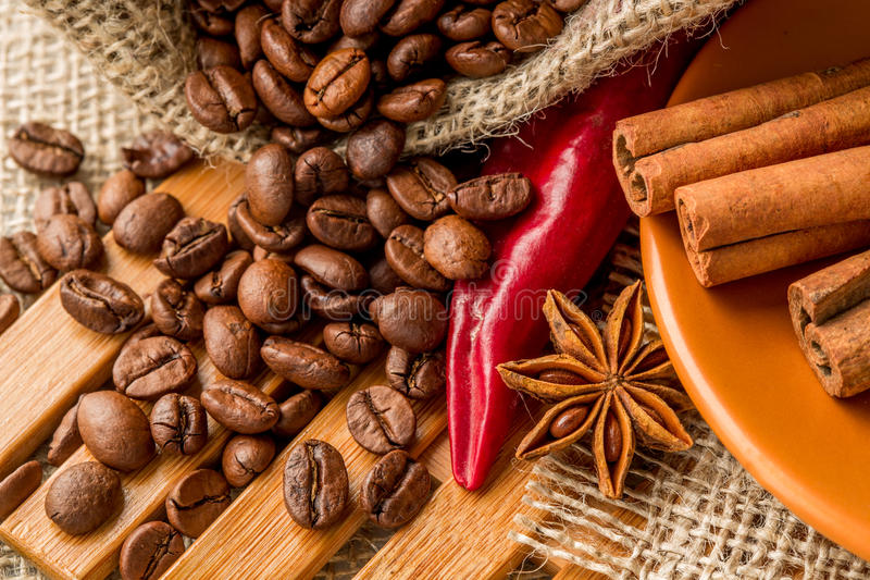 Red pepper, coffee beans, and star anise stock images