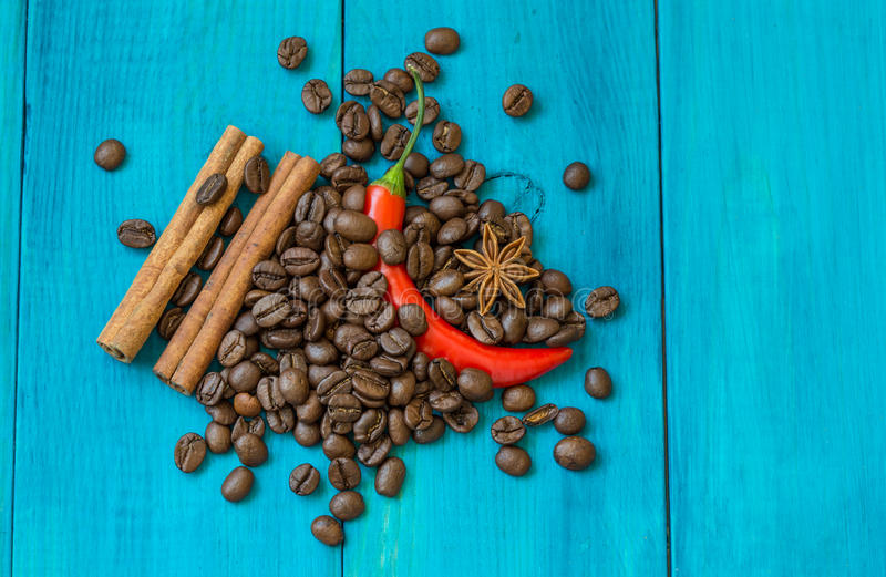 Red pepper, coffee beans, and star anise stock photography