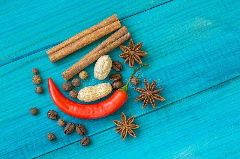Red pepper, coffee beans, and star anise stock image
