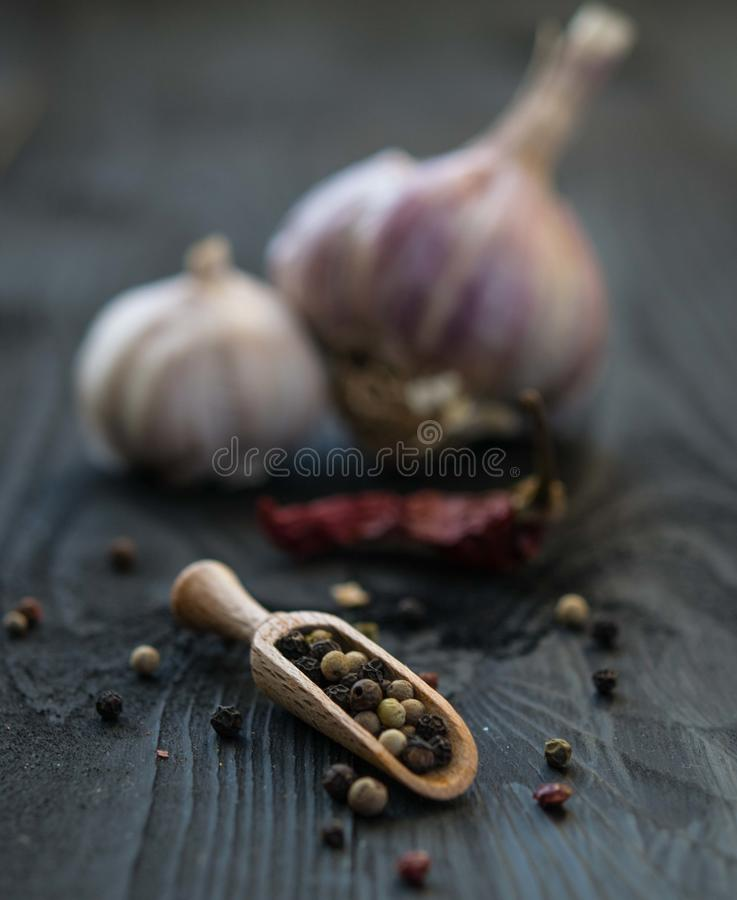 Red pepper garlic wood table scatter spice rustic kitchen cooking close up macro stock photography