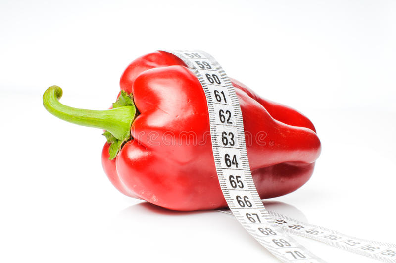 Red pepper in measure tape royalty free stock images