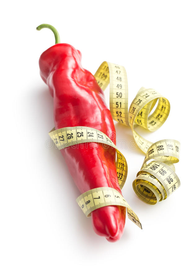 Red pepper and measuring tape royalty free stock photo
