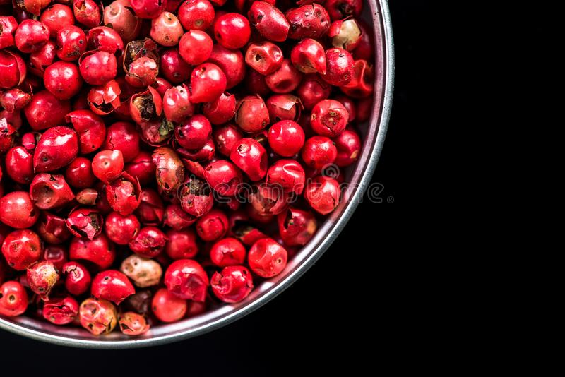 Red pepper seeds in pot with copy space royalty free stock photography