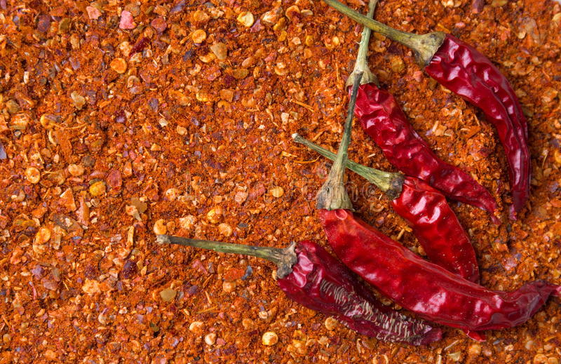 Red pepper on top ground paprika. Background stock images