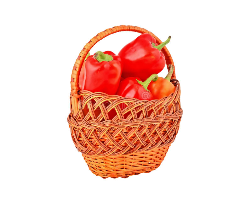 Red pepper in a wattled basket royalty free stock images