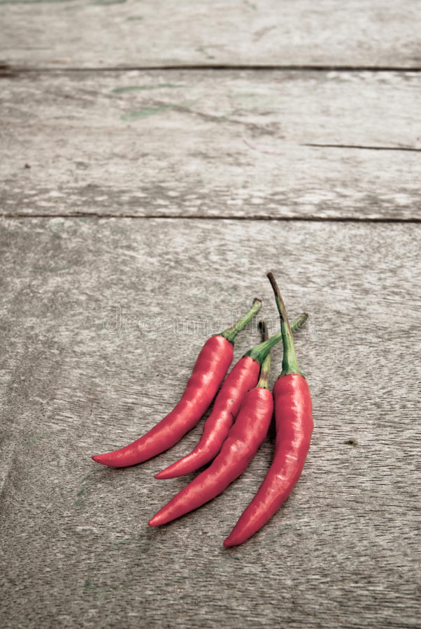 Download Red Pepper On A Wooden Floor Stock Photo - Image: 33750860