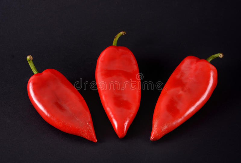 Red peppers. Ajvar. Red peppers on a black background. Ajvar royalty free stock images