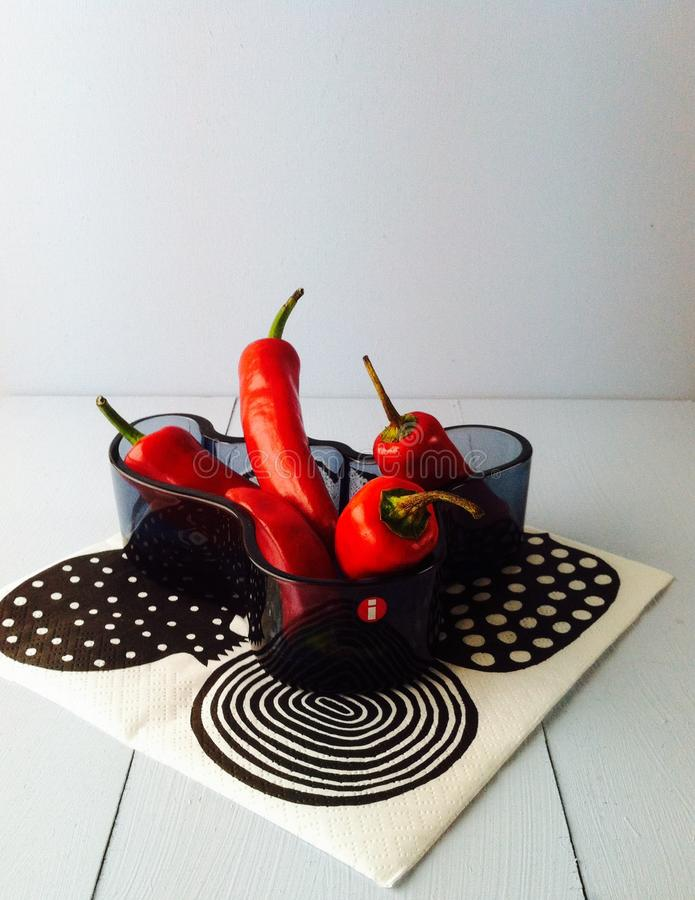 Red peppers in a blue bowl stock photos