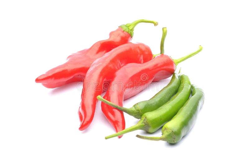 Red peppers and chili peppers. Red pappers and chili peppers isolated on the white royalty free stock images