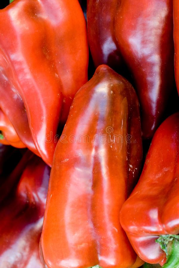 Red peppers closeup. Red peppers in a market place. Natural vegetables stock image