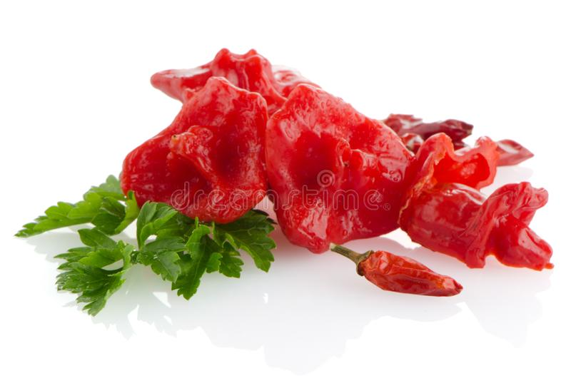 Red peppers closeup. On white background royalty free stock image