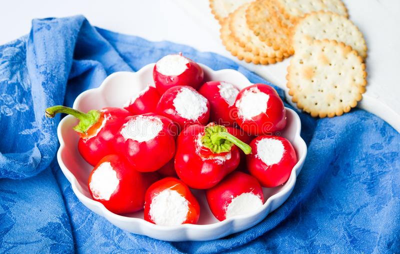 Red peppers stuffed with cheese royalty free stock photo