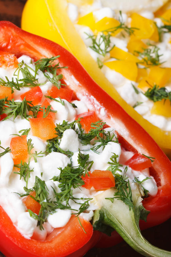 Red peppers stuffed with cottage cheese and vegetables macro royalty free stock photo