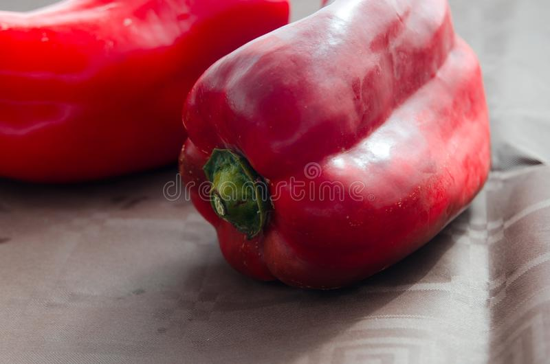 Red peppers, on table with brown tablecloth royalty free stock photo