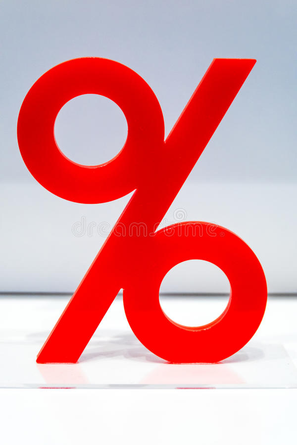 Red percentage icon on display in a store royalty free stock photos