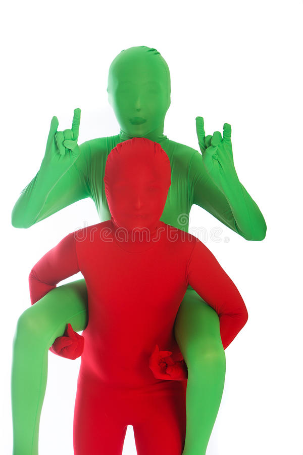 Red person giving gree person a ride stock images