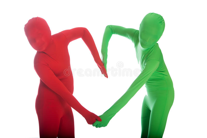 Red person and Green Person forming a heart shape stock photography