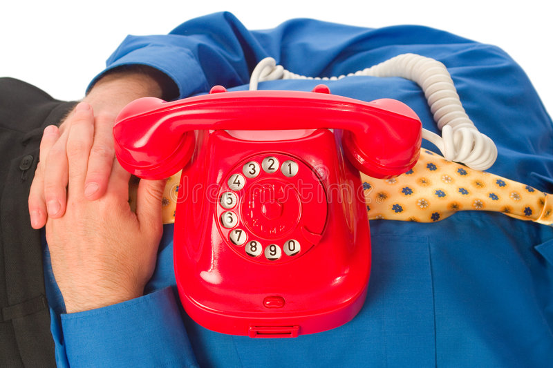 Red phone. Red classical phone placed on business man sleeping royalty free stock images
