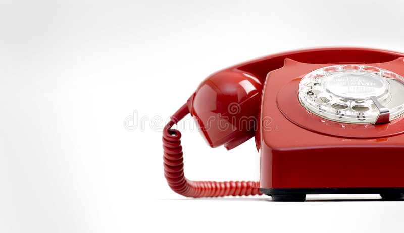 Red phone. A retro phone on white background
