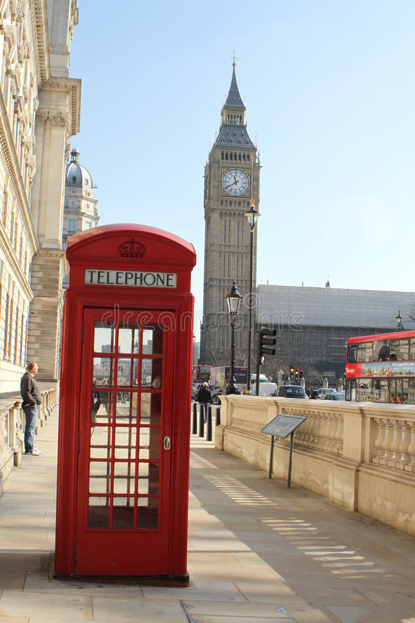 Red phone box and Big Ben, London. Traditional old red phone box with Saint Stephen's Tower - the location of Big Ben the bell and famous clock in the background royalty free stock photo