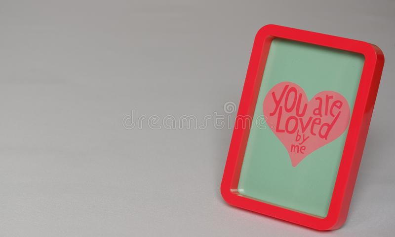Red photo frame with text in pink letters blue grey background. Red photo frame with text in pink heart blue grey background beautiful wedding valentine stock image