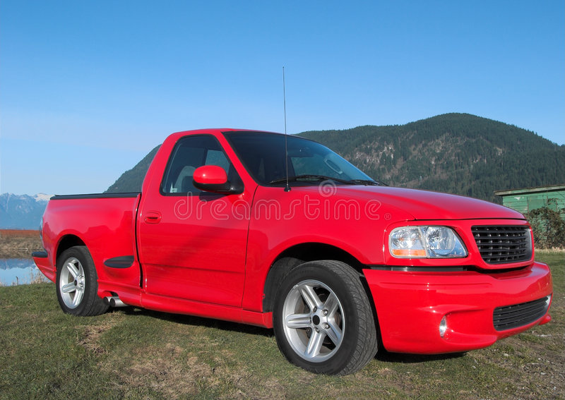 Red Pick up truck. With mountain back drop royalty free stock photos