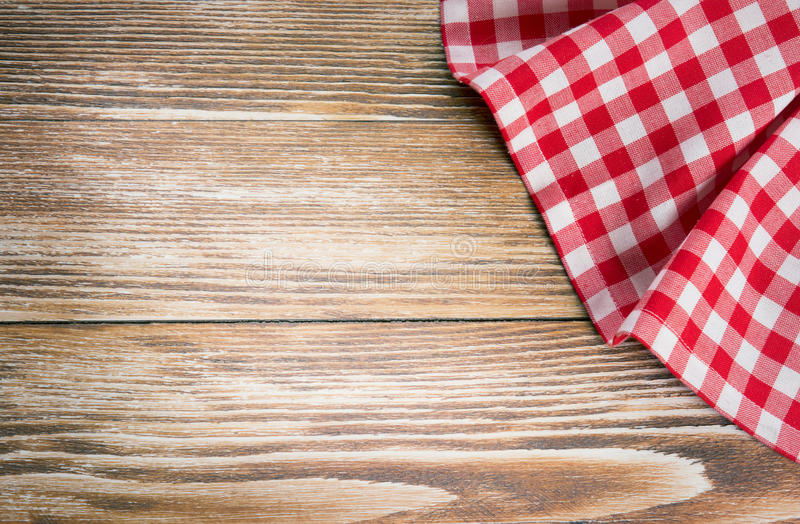 Red picnic cloth on wooden background.Napkin tablecloth on old w stock photo