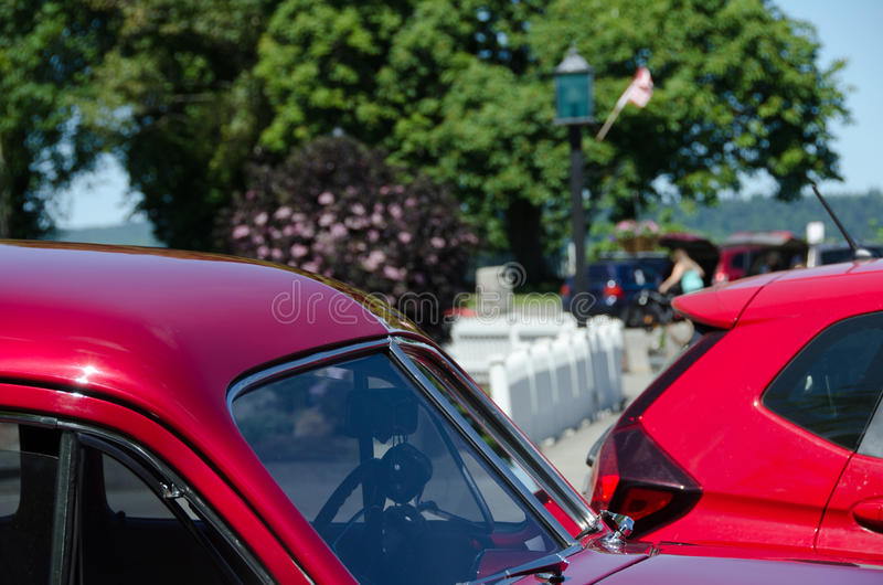 Red pillars of an old and new cars. In Port Gamble, Washington stock photos