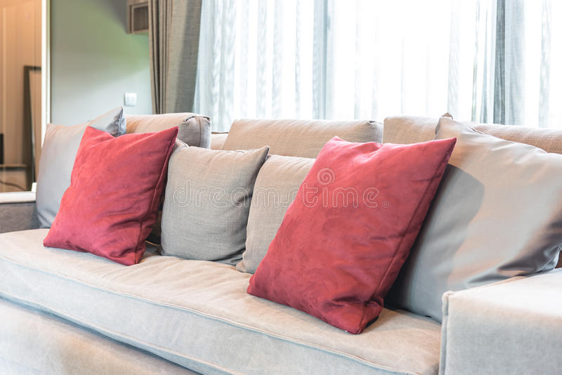 Red Pillows On Modern Grey Sofa Stock Image - Image of floor, chair ...