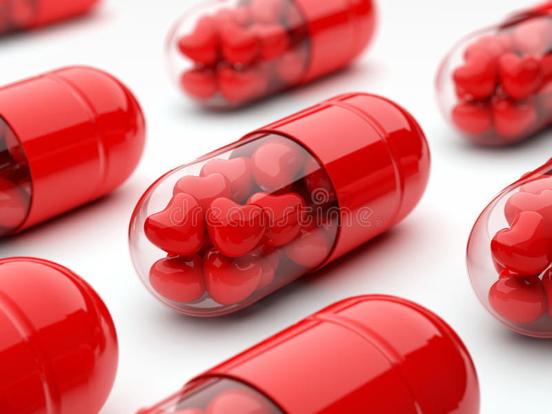 Red pills filled with hearts stock images