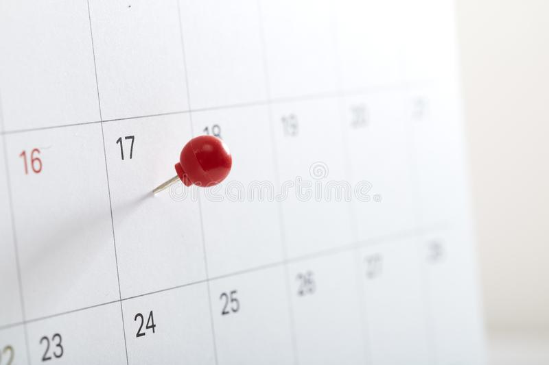 red pin on calendar to remind stock photography