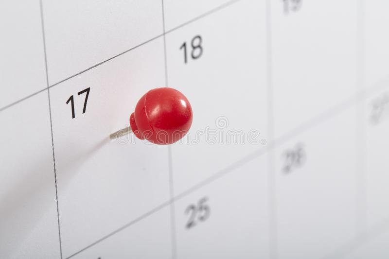 red pin on calendar to remind stock images