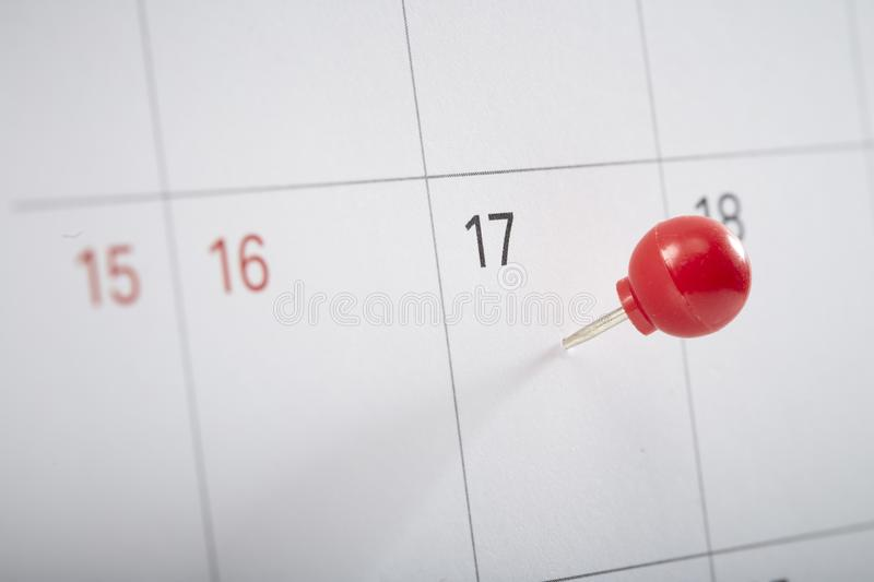 red pin on calendar to remind stock photos