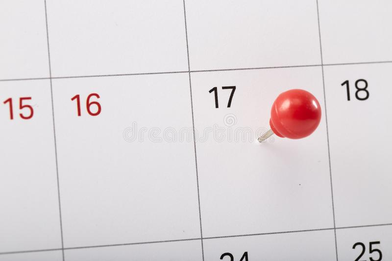 red pin on calendar to remind royalty free stock photos