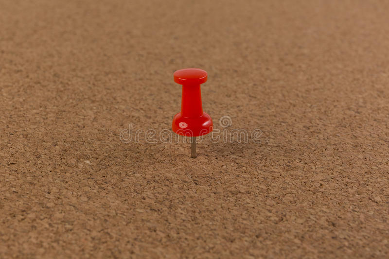 Red pin on Cork board texture background royalty free stock photos