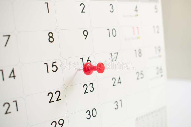 A red pin on the event calendar.background, close up, time stock photography