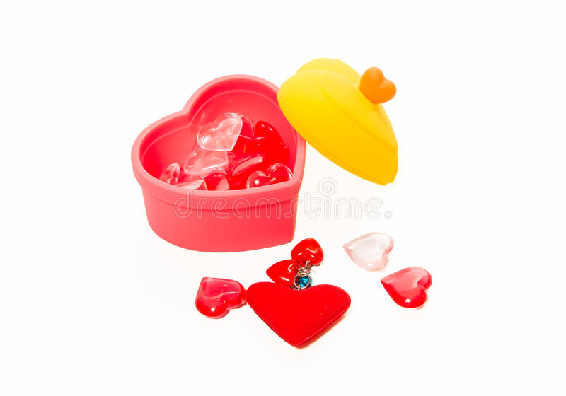Red and pink crystal heart shape in the box isolated on white background. Red and pink crystal heart shape in the heart shape box isolated on white background royalty free stock photography