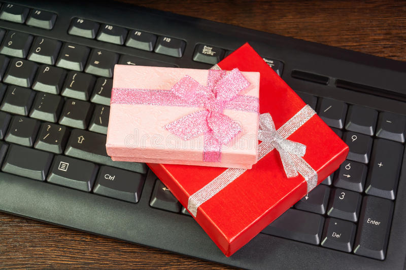Red and pink gift box on computer keyboard royalty free stock image