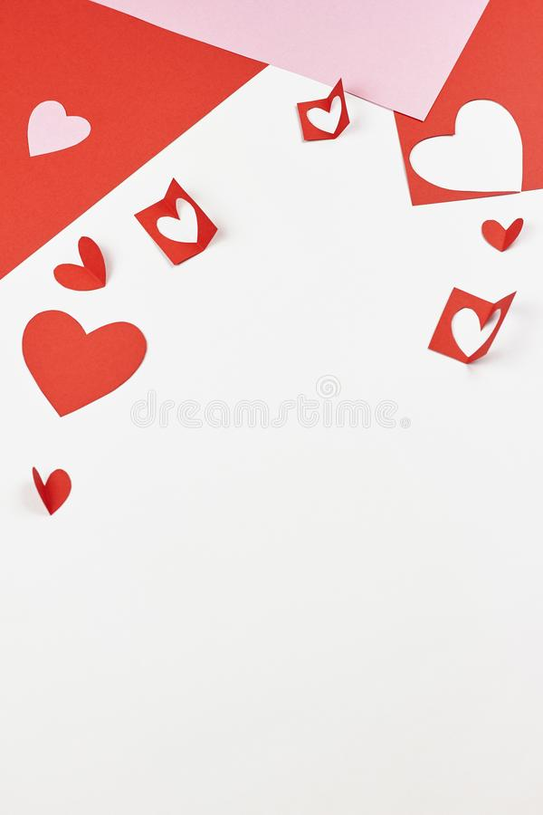 Red and pink paper hearts on white background. Valentine`s day, love, wedding concept stock photo