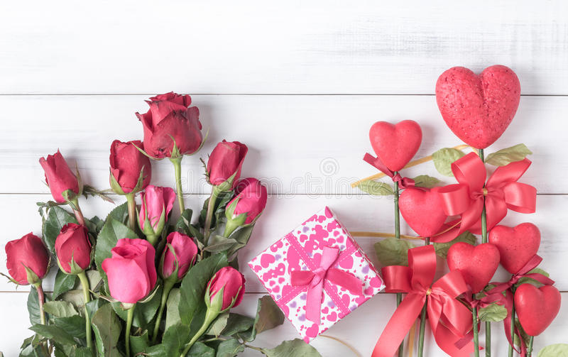 red and pink rose with gift box and red form heart on old vintage white wood stock photo