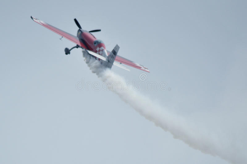 Red plane, Air show at Ahmedabad, India. THE GLOBAL STARS Team of U.K. based British Acrobatics Champions had performed amazing formation with 4 air craft at stock photos