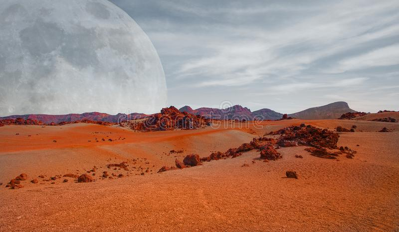 Red planet with arid landscape, rocky hills and mountains, and a giant Mars-like moon at the horizon. For space exploration and science fiction backgrounds stock image