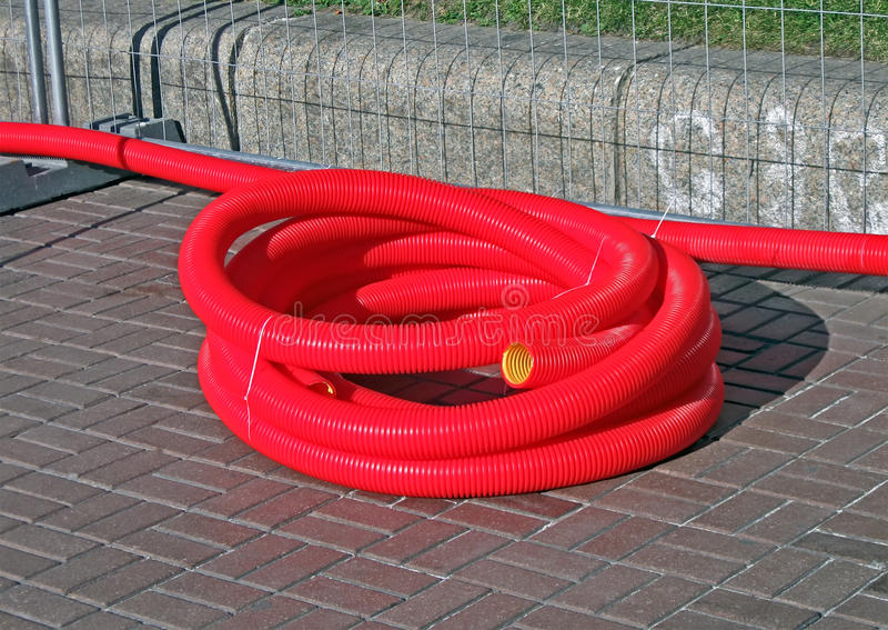 Download Red Plastic Cable Bulk On The Street, Stock Photo - Image: 25494160