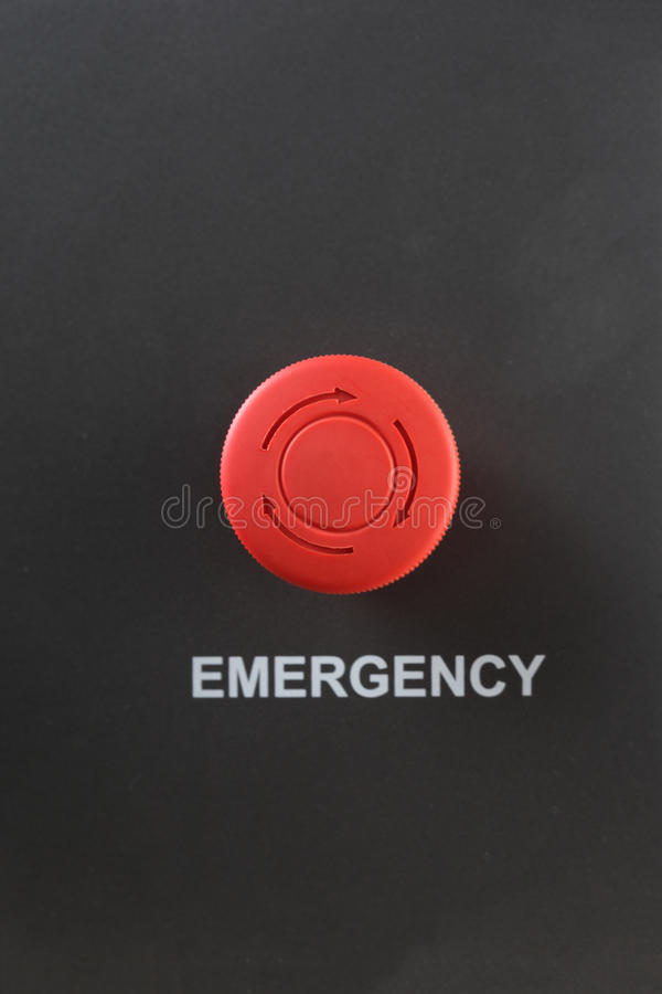 Red plastic emergency stop button stock image