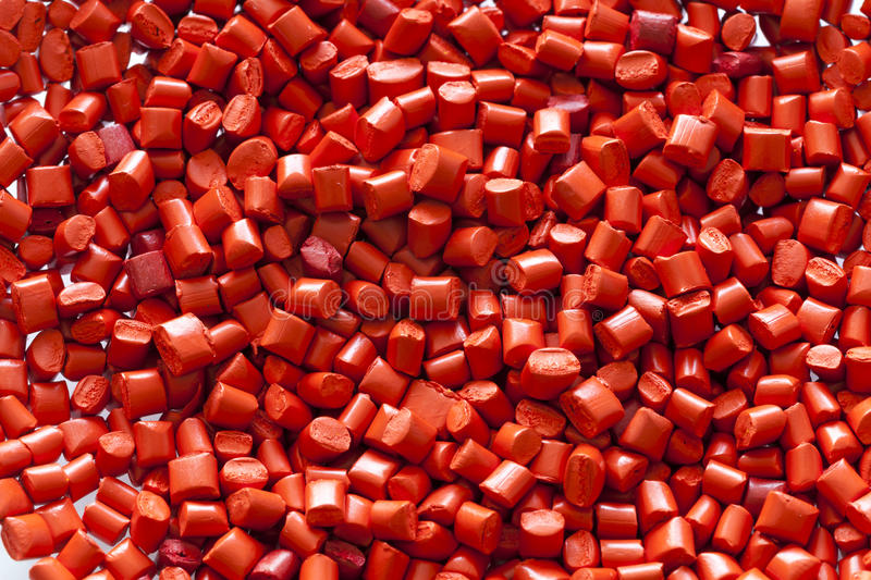 Red plastic granules royalty free stock photos